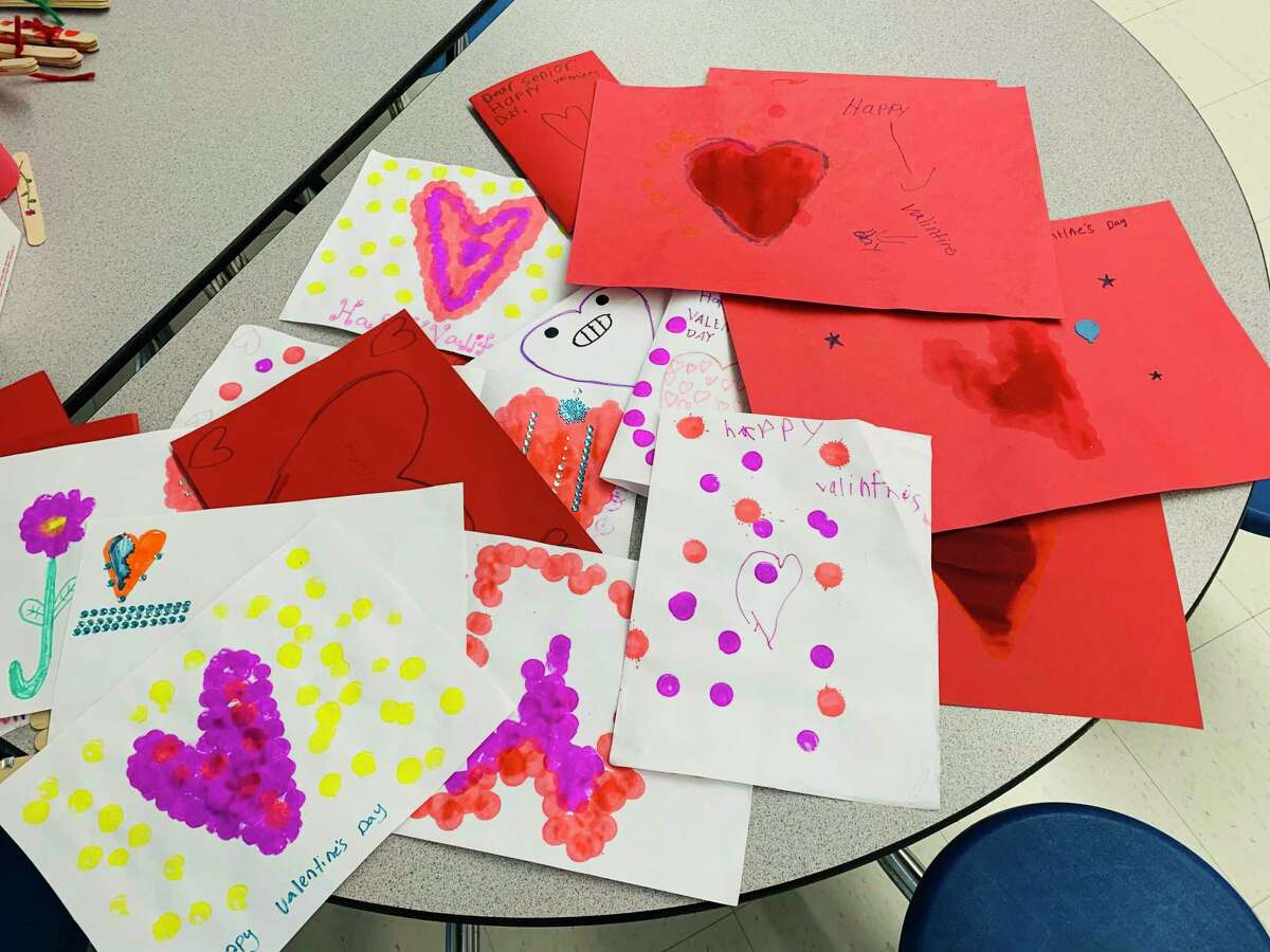 At Home in Darien recently welcomed students from the Ox Ridge Kids Care Club to make handmade cards for seniors.