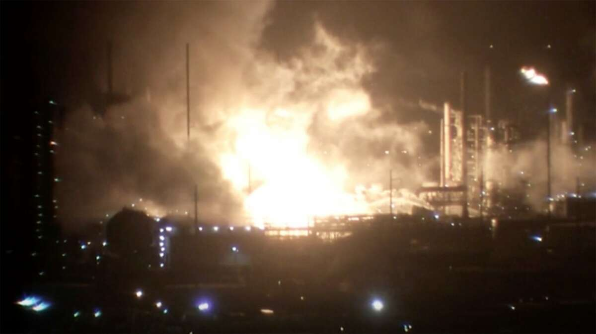 This image provided by WAFB shows a fire inside a refinery early Wednesday, Feb. 12, 2020 in Baton Rouge, La. The fire erupted at the ExxonMobil refinery late Tuesday, Baton Rouge Fire Department spokesman Curt Monte told news outlets. No injuries were reported and the fire was contained to the location where it started, Monte said. (WAFB via AP)