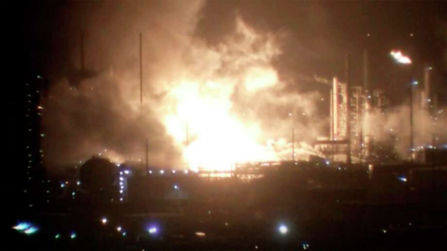 This image provided by WAFB shows a fire inside a refinery early Wednesday, Feb. 12, 2020 in Baton Rouge, La. The fire erupted at the ExxonMobil refinery late Tuesday,  Baton Rouge Fire Department spokesman Curt Monte told news outlets. No injuries were reported and the fire was contained to the location where it started, Monte said.  (WAFB via AP) Photo: Associated Press / WAFB