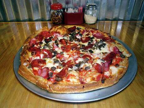The Max Out Meat pizza includes pepperoni, ham, beef, sausage and bacon at Tank's Pizza.