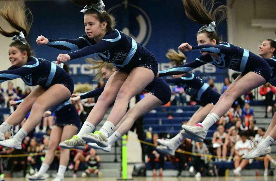 The Wilton High School cheerleading squad competes during the FCIAC cheerleading championships at Wilton High School in Wilton, Conn. Photo: Erik Trautmann / Hearst Connecticut Media / Norwalk Hour