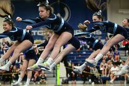 The Wilton High School cheerleading squad competes during the FCIAC cheerleading championships at Wilton High School in Wilton, Conn.