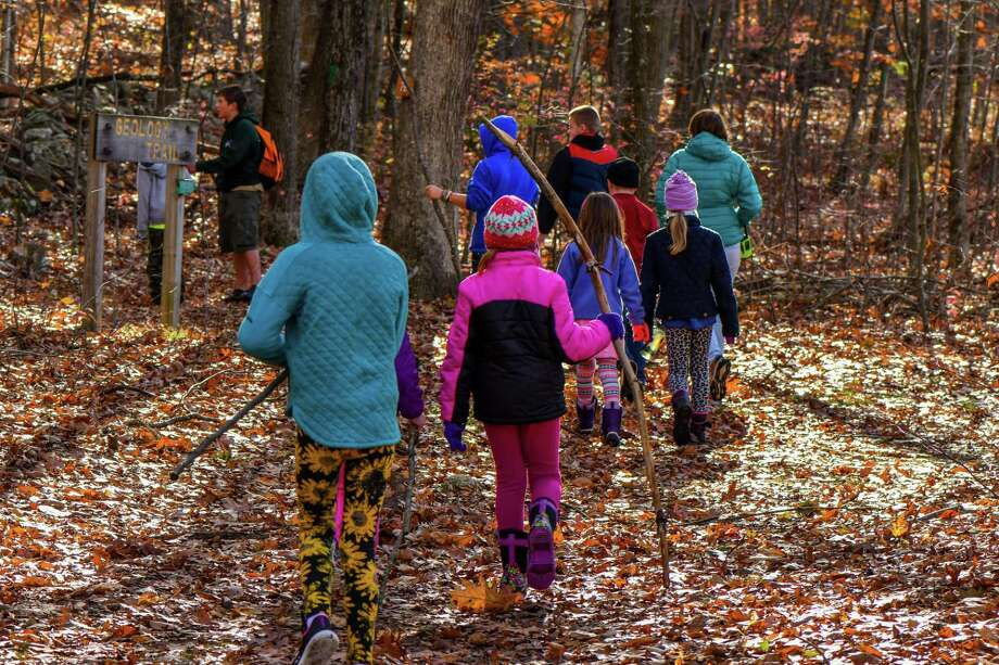 Flanders Nature Center visitors enjoy a fall program at the Woodbury nonprofit. Photo: Contributed Photo /