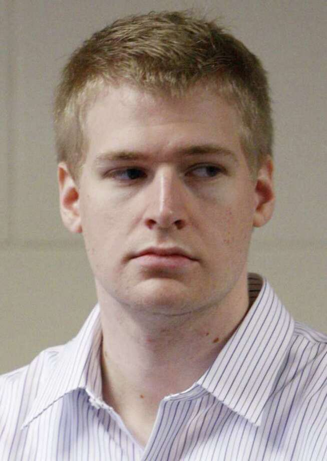 In this June 22, 2009 file photo, former Boston University medical student Philip Markoff stands during his arraignment in Suffolk Superior Court in Boston, on charges he killed a masseuse at a Boston hotel that he met through Craigslist. Officials confirmed that Markoff was found dead of apparent suicide in his jail cell Sunday, Aug. 15, 2010 in Boston.   (AP Photo/Bizuayehu Tesfaye, Pool, File) Photo: Bizuayehu Tesfaye