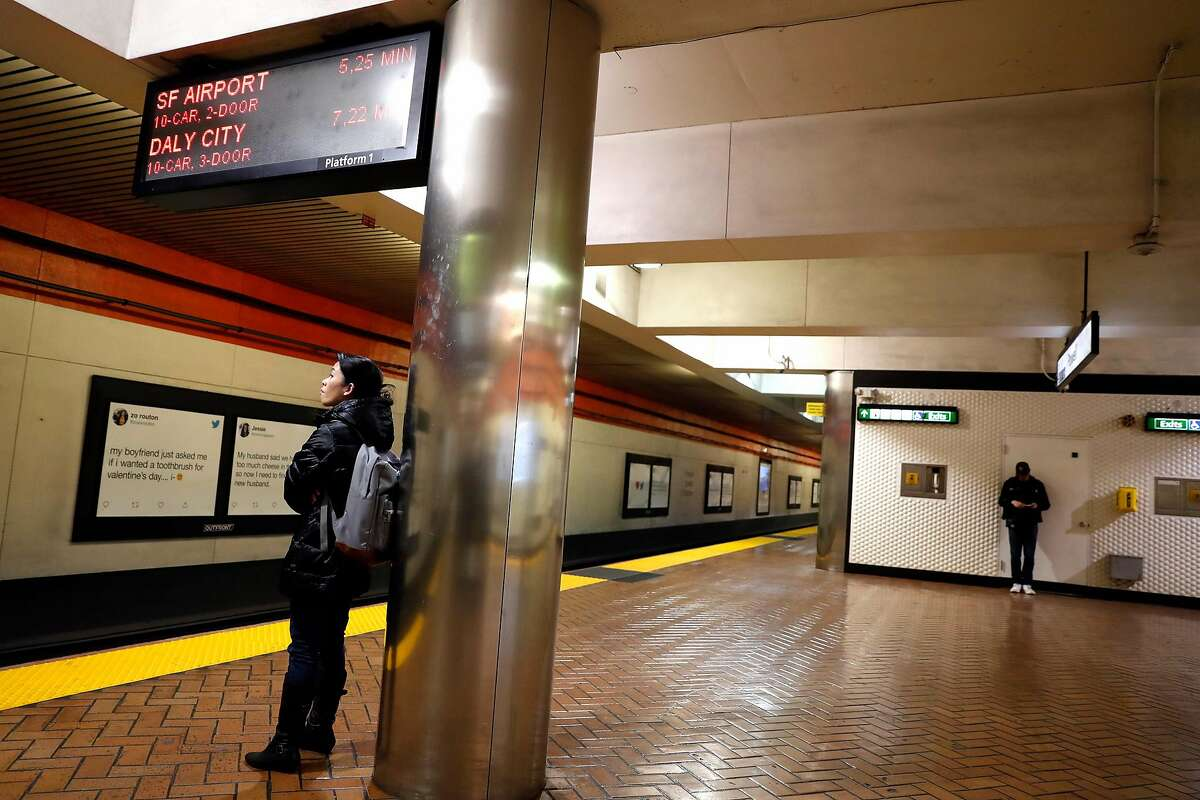 Two commuters wait for a train at BART Powell Street station in San Francisco, Calif., on Tuesday, February 11, 2020.