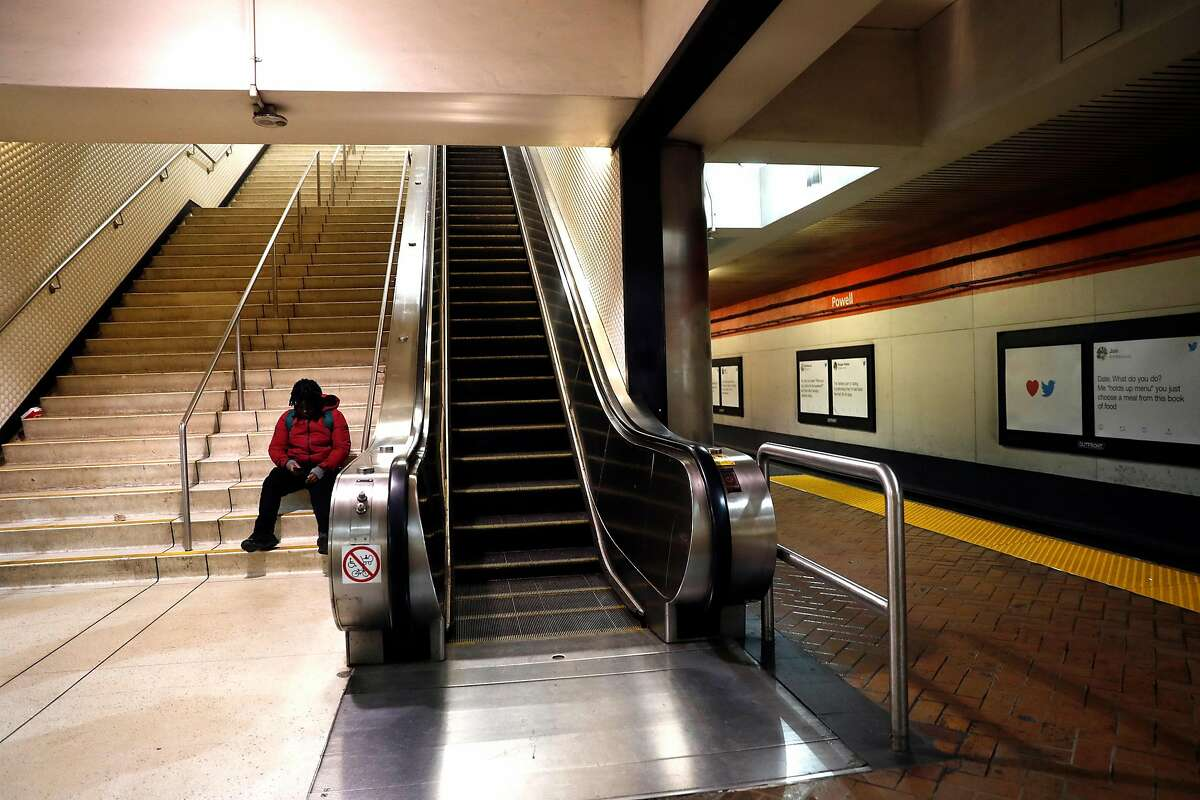 A man sits on the steps at BART Powell Street station in San Francisco, Calif., on Tuesday, February 11, 2020.