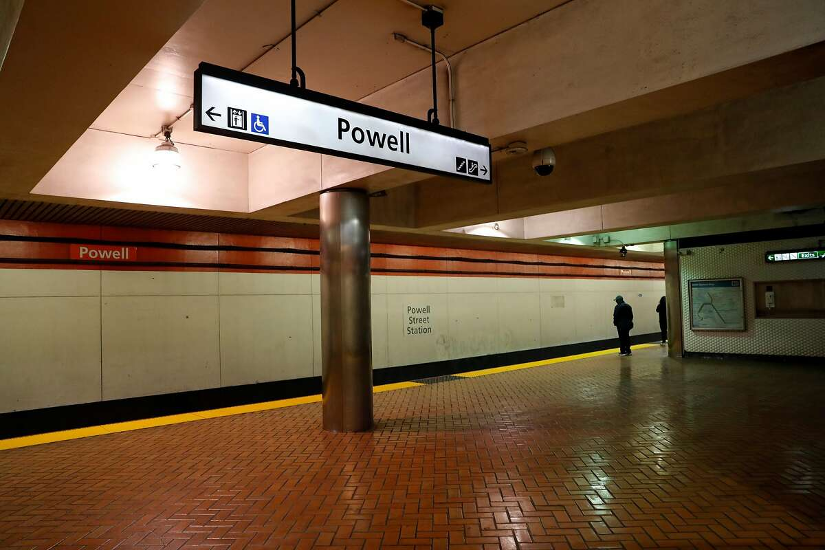 Two people wait for a train at BART Powell Street station in San Francisco, Calif., on Tuesday, February 11, 2020.