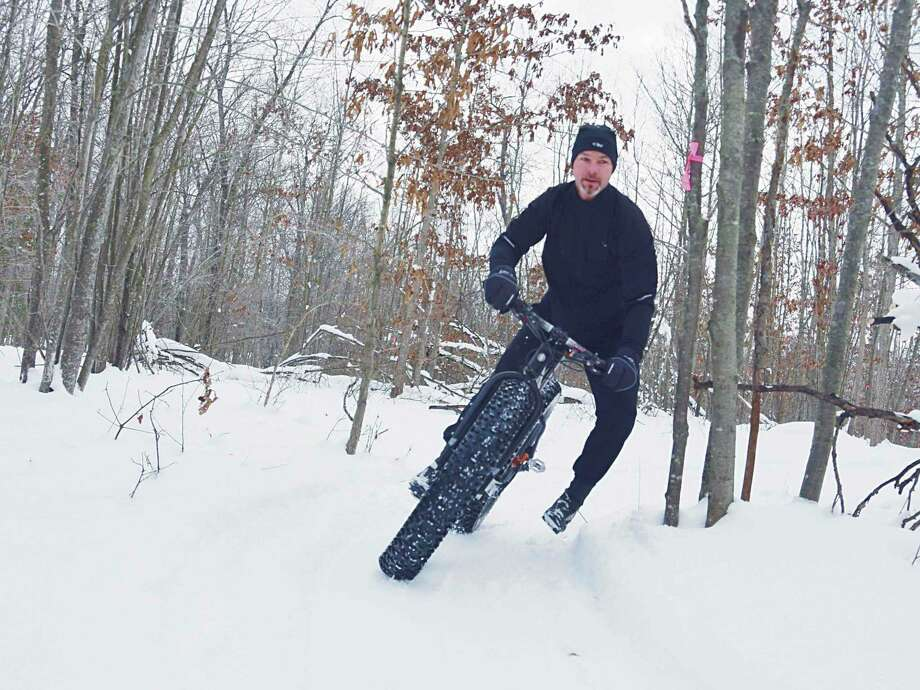 Fat biking is a popular activity at Big M Cross-Country Ski and Mountain Bike Trail in Manistee County. The Huron-Manistee National Forests will waive fees at most of its day-use recreation sites on Presidents Day, Feb. 17 -- this includes at Big M. (Courtesy photo)