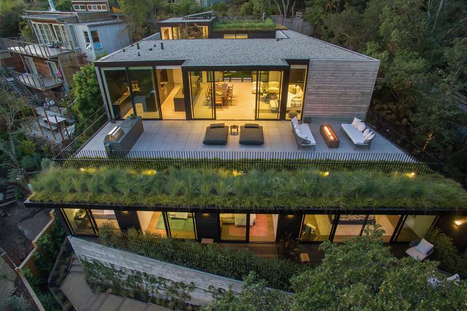Architect Stanley Saitowitzdesigned the home with terraced levels and green roofs to fit into the hillside. Photo: Open Homes Photography