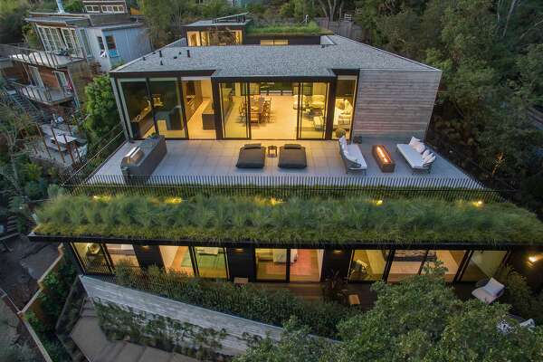 Architect Stanley Saitowitz designed the home with terraced levels and green roofs to fit into the hillside.