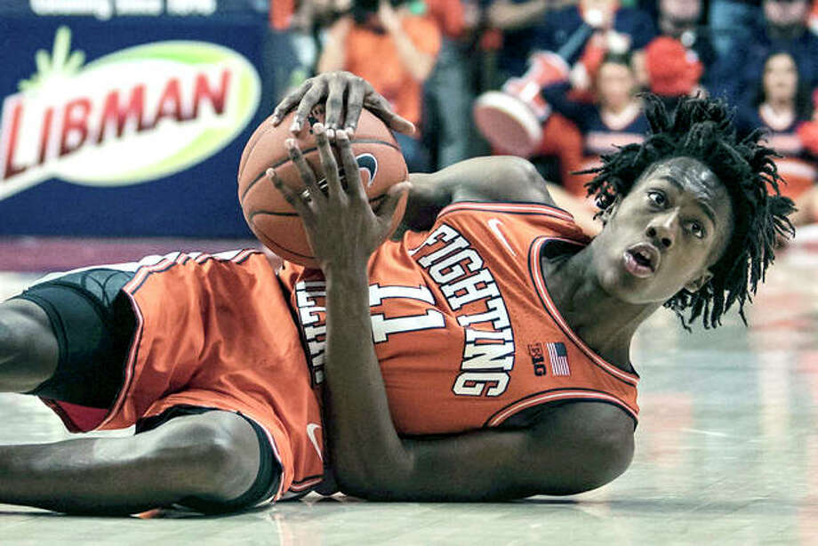 Ayo Dosunmu of Illinois(11) reacts to being called for a foul while attempting to steal the ball against Michigan State Tuesday in Champaign. Dosunmu was injured at the end of the loss to the Spartans. Photo: AP Photo