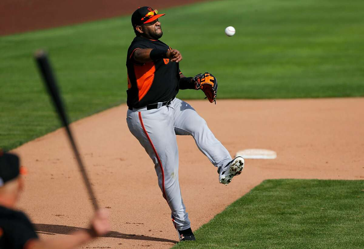 Giants' third baseman Pablo Sandoval, (48) turns and throws to first during drills at Scottsdale Stadium in Scottsdale, Arizona on Friday Feb. 21, 2014. The San Francisco Giants continue their spring training schedule in the Arizona desert in preparation for the 2014 MBL season.