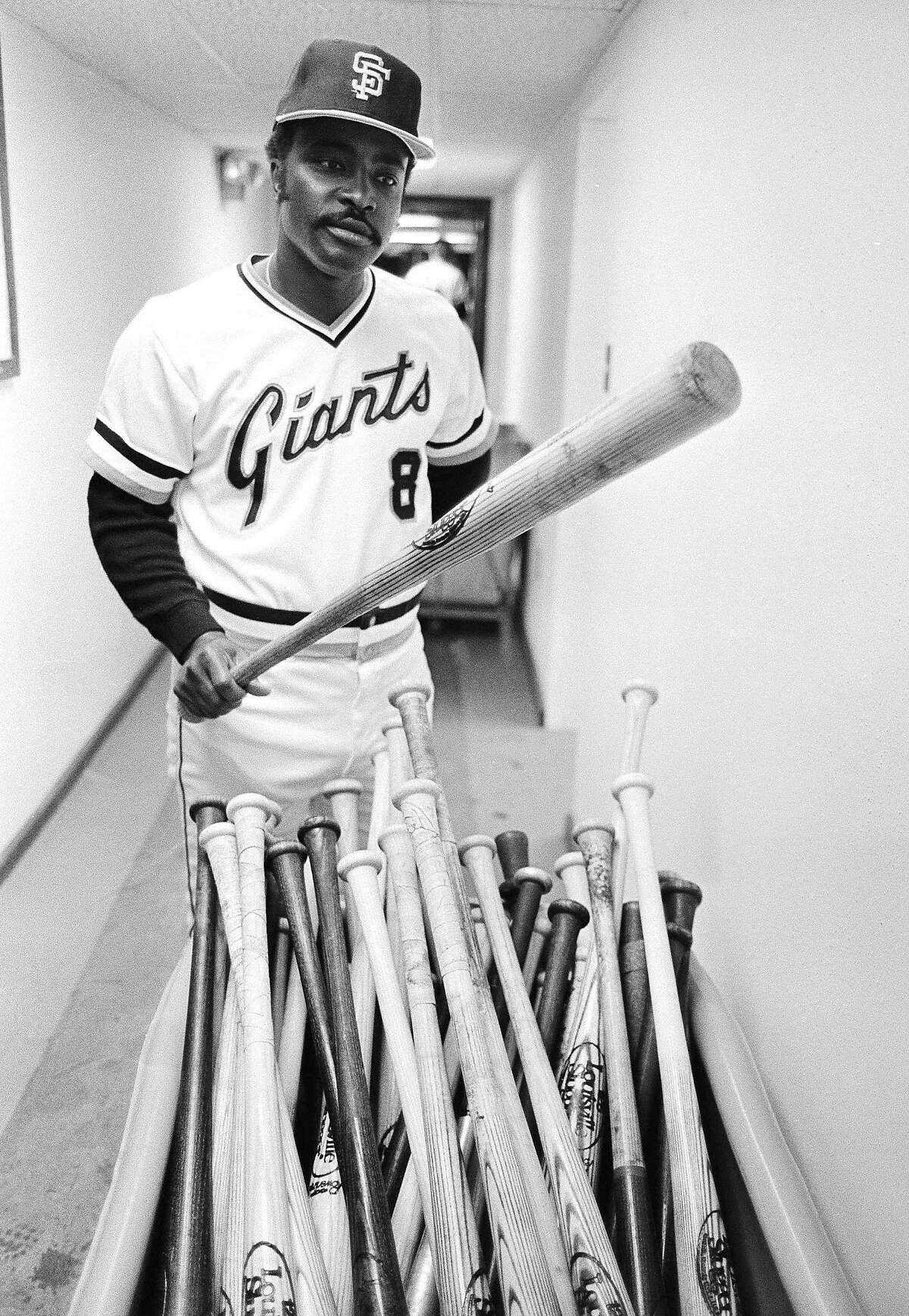 San Francisco Giants second baseman Joe Morgan who knows his way around the major leagues, selects a bat from a tub full in Giants clubhouse in Scottsdale, Arizona, on March 18, 1982. Among the most popular of models is the S-2 used by Vern Stevens. (AP Photo/Sal Veder)