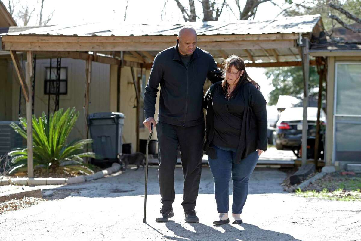 Ron is steadied by his wife Ann Jones during a walk break as they deal with a massive headache of paperwork and worries on Feb. 6, 2020, after hiring Synergy, a company offering loan modification services.