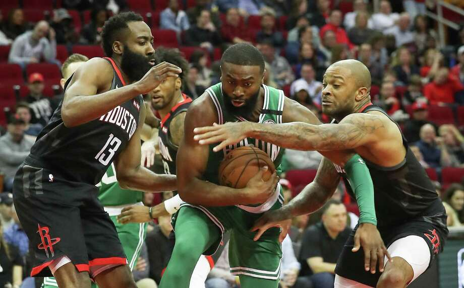 PHOTOS: Rockets vs. Celtics The Rockets' James Harden (13) and P.J. Tucker (17) blanket Celtics guard Jaylen Brown during Tuesday's game at Toyota Center. >>>See photos from the last meeting between the two teams ... Photo: Steve Gonzales, Houston Chronicle / Staff Photographer / © 2020 Houston Chronicle