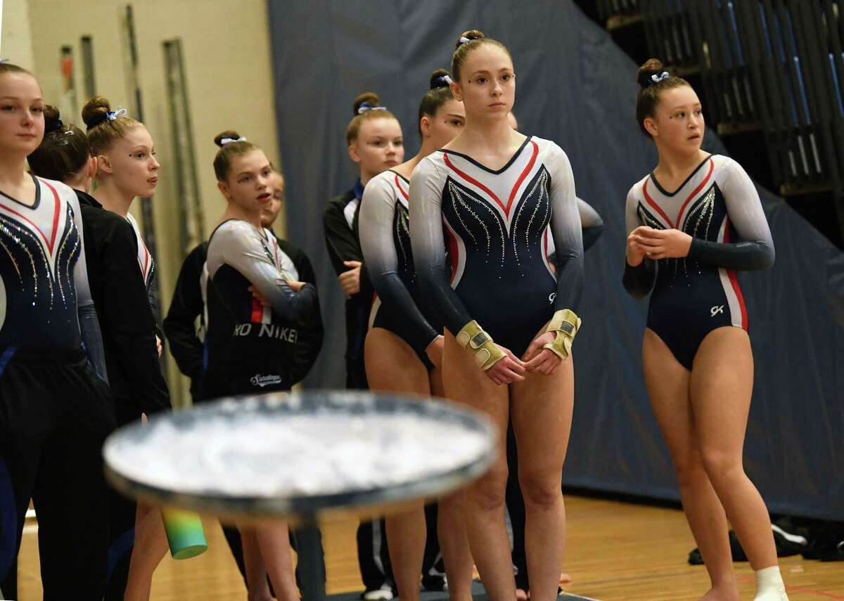 Saratoga's Ava Dallas, second from right, gets ready compete in the vault during the Section II Gymnastics sectionals at Shaker High School on Wednesday, Feb. 12, 2020 in Latham, N.Y. (Lori Van Buren/Times Union)