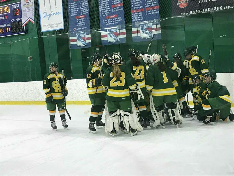 The Greenwich Academy ice hockey team celebrates its 3-2 overtime win over Taft School on Wednesday, February 12, 2020, at Chelsea Piers Connecticut in Stamford. Photo: Contributed Photo