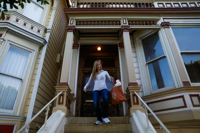 Leah Culver, who has purchased the Pink Painted Lady, walks out of her newly purchased home on Steiner Street.