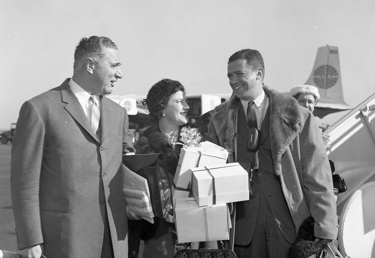 Chronicle reporter Mel Wax is at the airport ready to join George Christopher and his wife on their trip to Moscow and the Soviet Union, February 19, 1960