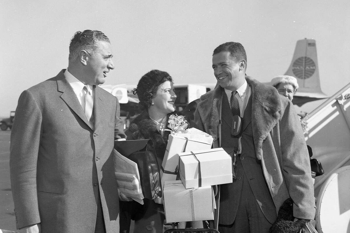 George Christopher (left), pictured with wife Tula and reporter Mel Wax, was the first Greek American chief exec of a major U.S. city when elected in 1955.