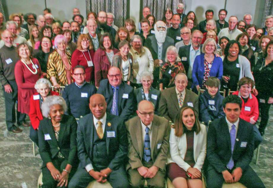 Tom Kennedy, second row, third from left, of Shelton was among several people from Shelton and across Fairfield County who posed with Charles Darwin's likeness at the Darwin Day Dinner on Feb. 8. Photo: Contributed Photo / / Connecticut Post