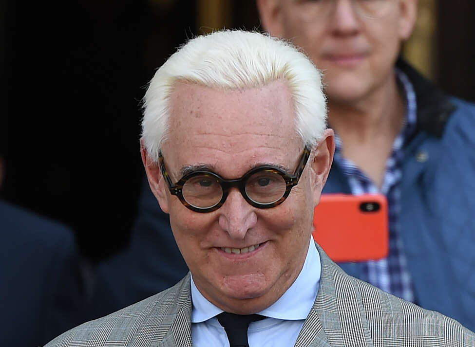 (FILES) In this file photo taken on March 14, 2019 former advisor to US President Donald Trump, Roger Stone, leaves a court hearing in Washington DC. - The US Justice Department is intervening to override its own prosecutors and seek a lower prison sentence for Roger Stone, a former campaign advisor of President Donald Trump, after Trump complained on Twitter, media reports said on February 11, 2020. A senior Justice official told US media that the seven-to-nine year sentence that prosecutors recommended Monday for Stone, convicted of lying to Congress and witness tampering, was too stiff for the level of crime committed. (Photo by Andrew CABALLERO-REYNOLDS / AFP) (Photo by ANDREW CABALLERO-REYNOLDS/AFP via Getty Images)