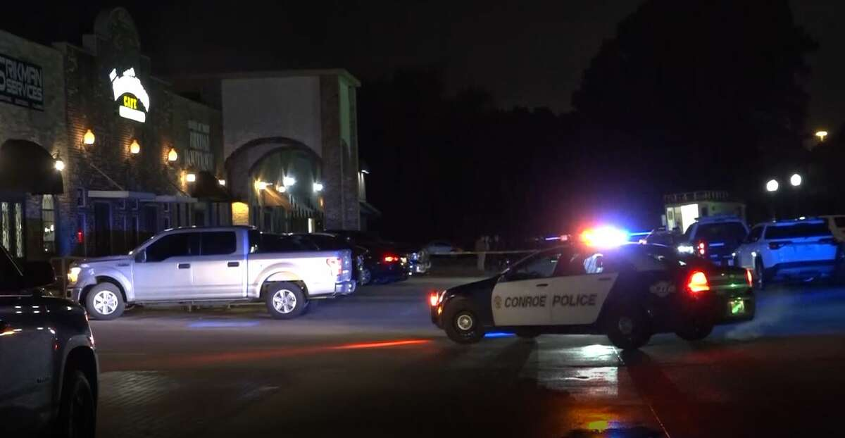 Conroe police investigate a double homicide Feb. 12, 2020, at a shopping center on I-45 at Creighton Road.