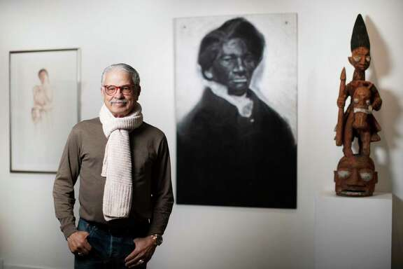 Andy Moran has spent years investing in art by painters in the Third Ward. He's accumulated a remarkable collection of art by African-American artists that is now being displayed for Black History Month at the Heidi Vaughan Fine Art gallery and he's also lecturing at TSU about the art. Moran stands for a portrait in front of a piece done in charcoal of American social reformer and writer Frederick Douglass by Julian Joseph Kyle on Tuesday, Feb. 11, 2020, in Houston.