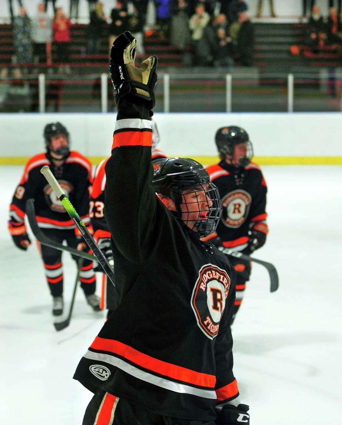 Ridgefield's Cornelius van Wees (8) celebrates his goal against Fairfield Prep during boys high school ice hockey action in Bridgeport, Conn., on Wednesday Feb. 12, 2020.