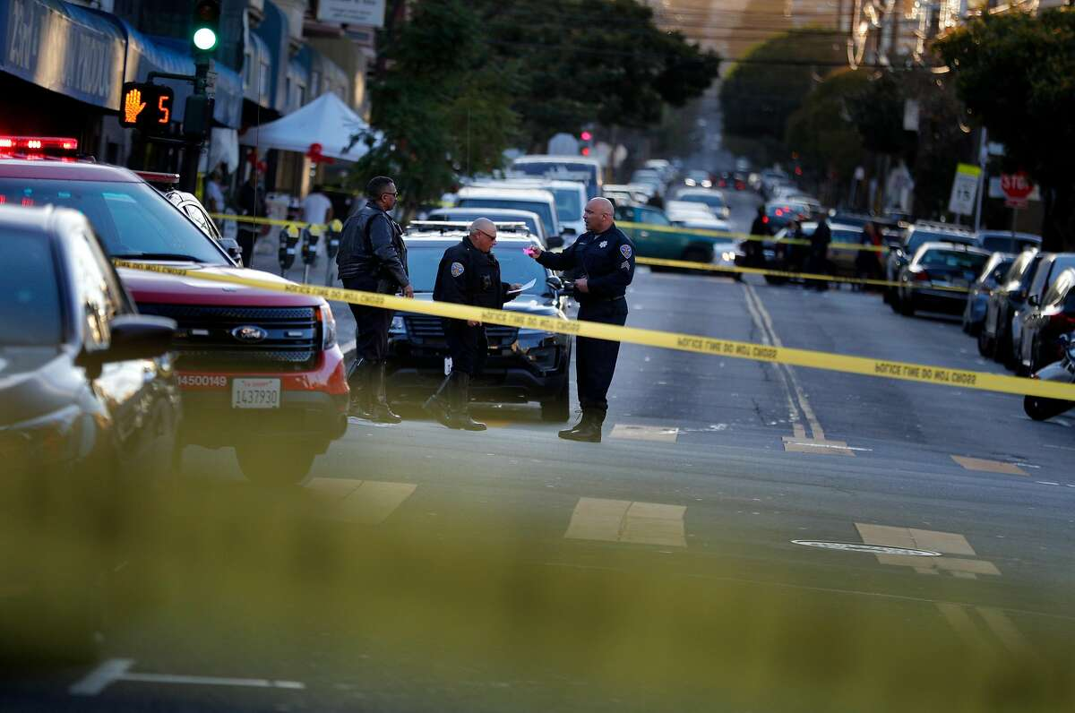 SFPD officers investigate the scene of a hit and run accident at the intersetion of 23rd Street and Mission Street after a driver hit three pedestrians, left the scene and then returned to cooperate with police in San Francisco, Calif., on Wednesday, February 12, 2020.