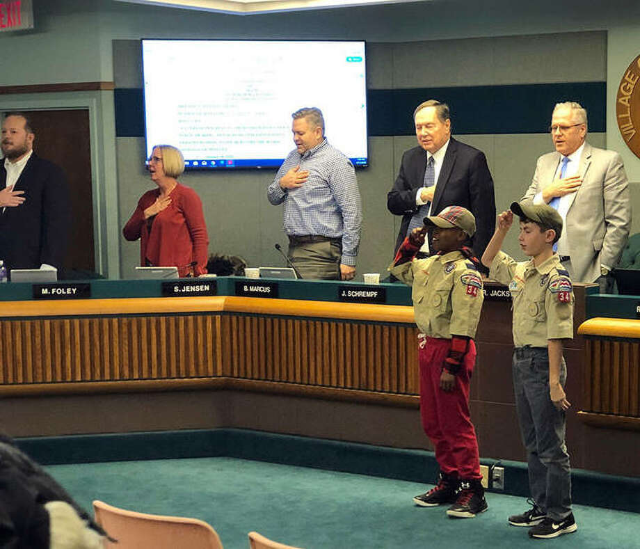 Cub Scouts from Den #3 led Mayor Rob Jackstadt, background right, village trustees and other attendees in the Pledge of Allegiance Tuesday before the village trustee meeting. Photo: Charles Bolinger|The Intelligencer