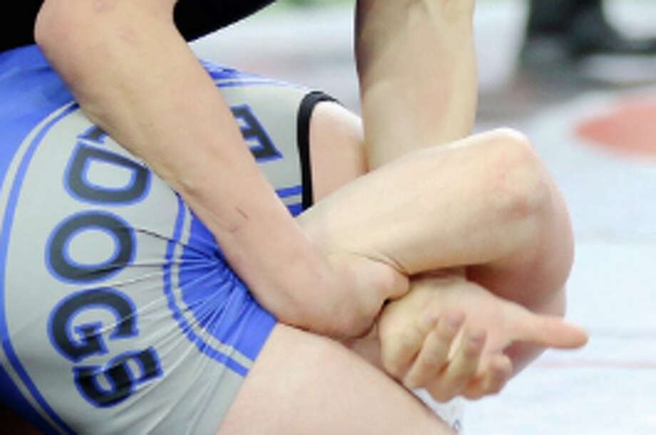 Ubly's Logan Mueller took his place as the Greater Thumb Conference champion in the 160-pound weight bracket when the Bearcats wrestler took first place over the weekend. Photo: Tribune File Photo