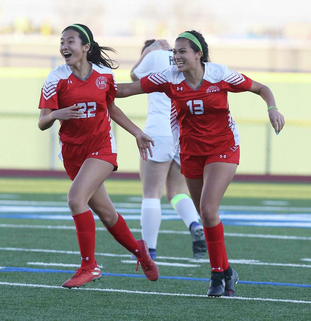 LEE's Kyleena Xin (22) celebrates with teammate Isela Zertuche (13) after Xin scores in the second half against Reagan during their girls soccer game at Commander Stadium on Wednesday, Feb. 12, 2020. LEE defeated Reagan, 1-0, on Xin's score.