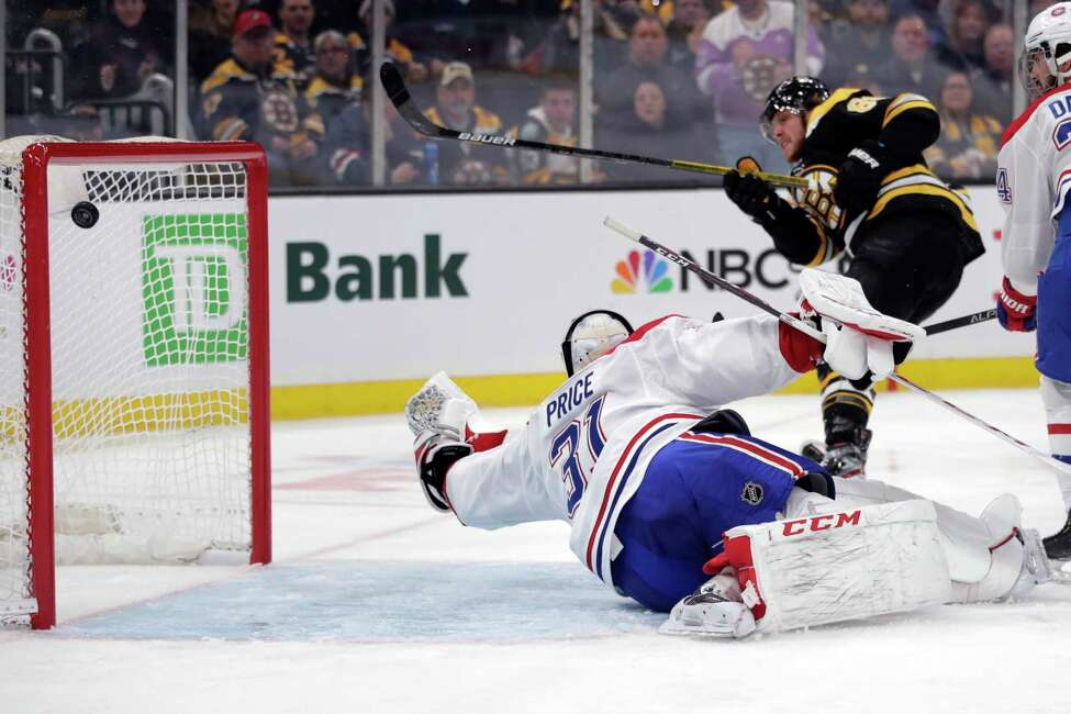 Montreal Canadiens goaltender Carey Price (31) reaches back as Boston Bruins right wing David Pastrnak (88) scores, his third of the game, during the second period of an NHL hockey game in Boston, Wednesday, Feb. 12, 2020. (AP Photo/Charles Krupa)