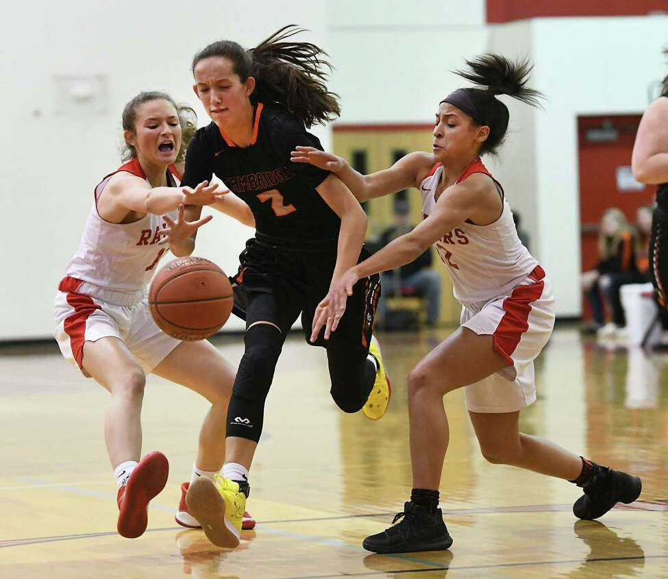 Cambridge's Sophie Phillips drives to the basket guarded by Mechanicville's Charli Goverski, left, and Jada Brown during a game on Wednesday, Feb. 12, 2020 in Mechanicville, N.Y. (Lori Van Buren/Times Union)