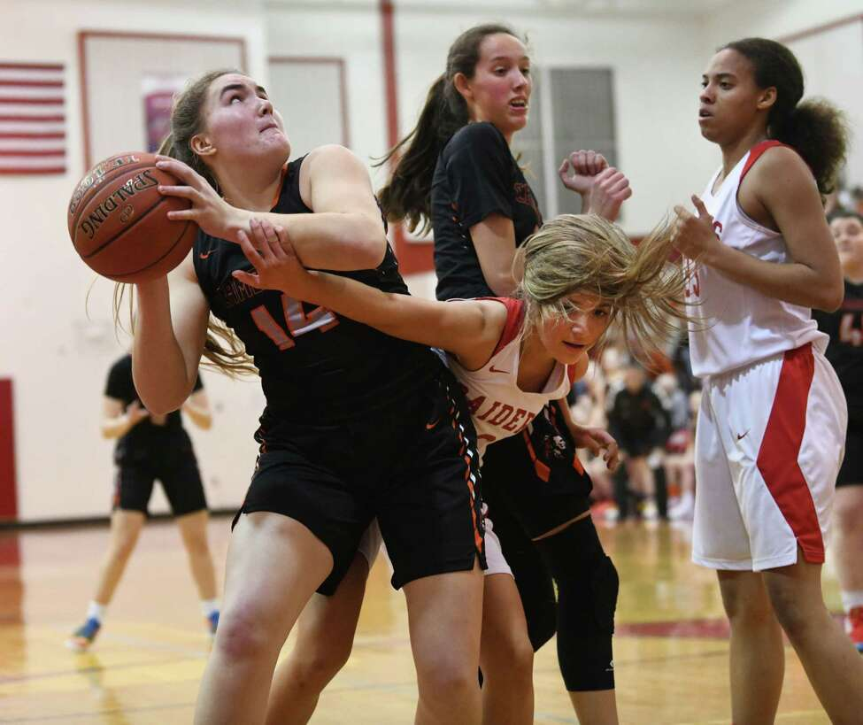 Cambridge's Fiona Mooney takes a shot guarded by Mechanicville's Chloe Goverski during a game on Wednesday, Feb. 12, 2020 in Mechanicville, N.Y. (Lori Van Buren/Times Union)