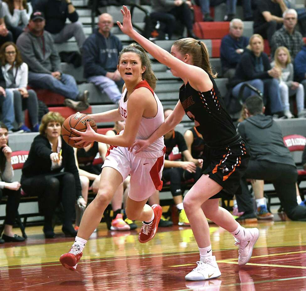 Mechanicville's Charli Goverski drives to the basket guarded by Cambridge's Ruth Nolan during a game on Wednesday, Feb. 12, 2020 in Mechanicville, N.Y. (Lori Van Buren/Times Union)