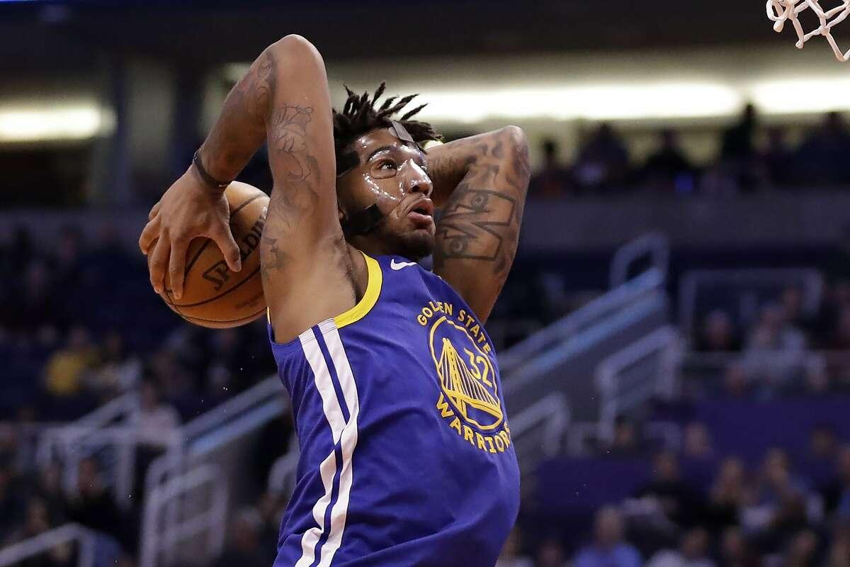FILE: Golden State Warriors forward Marquese Chriss (32) dunks against the Phoenix Suns during the first half of an NBA basketball game, Wednesday, Feb. 12, 2020, in Phoenix. (AP Photo/Matt York)