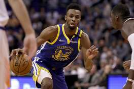 Golden State Warriors guard Andrew Wiggins (22) drives against the Phoenix Suns during the first half of an NBA basketball game, Wednesday, Feb. 12, 2020, in Phoenix. (AP Photo/Matt York)
