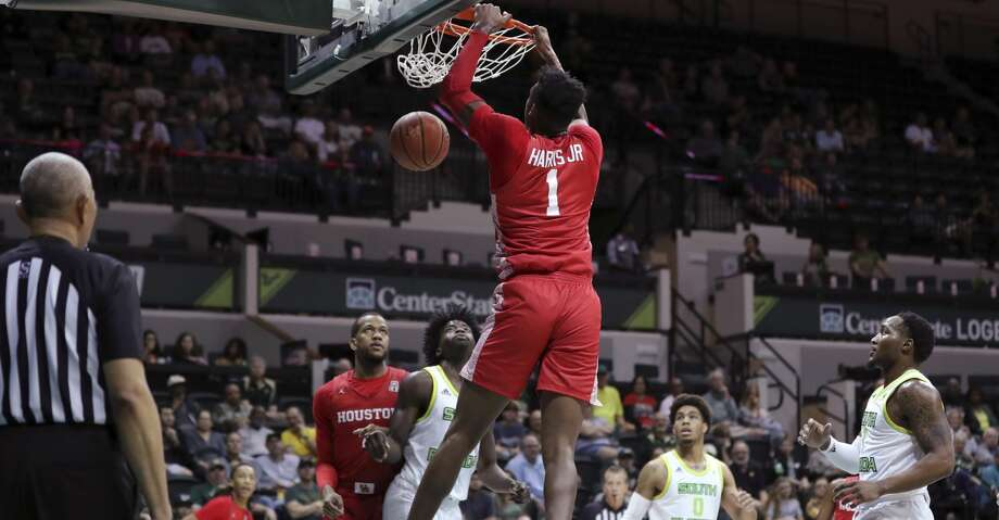 Houston's Chris Harris Jr. dunks against South Florida during the first half of an NCAA college basketball game Wednesday, Feb. 12, 2020, in Tampa, Fla. (AP Photo/Mike Carlson) Photo: Mike Carlson/Associated Press