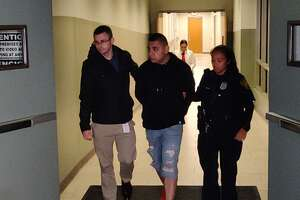 David Donjuan, 25, is accused of fatally shooting a woman as soon as she answered the door and injuring a man on Feb. 1.