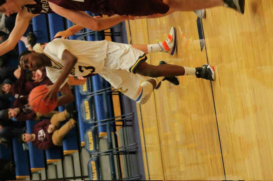 Baldwin's Carmelo Lindsey goes tothe basket against Marion on Jan. 31. (Star photo/John Raffel)