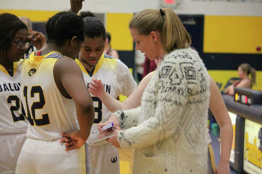 Baldwin girls basketball coach Nikki Bergman designs a play for her team. (Star photo/John Raffel)