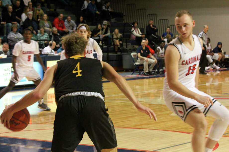 Big Rapids' LJ Graves (15) keeps an eye on a player in action earlier this season. (Pioneer file photo)