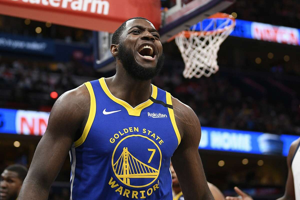 Golden State Warriors forward Eric Paschall (7) reacts during the first half of an NBA basketball game against the Washington Wizards, Monday, Feb. 3, 2020, in Washington. (AP Photo/Nick Wass)