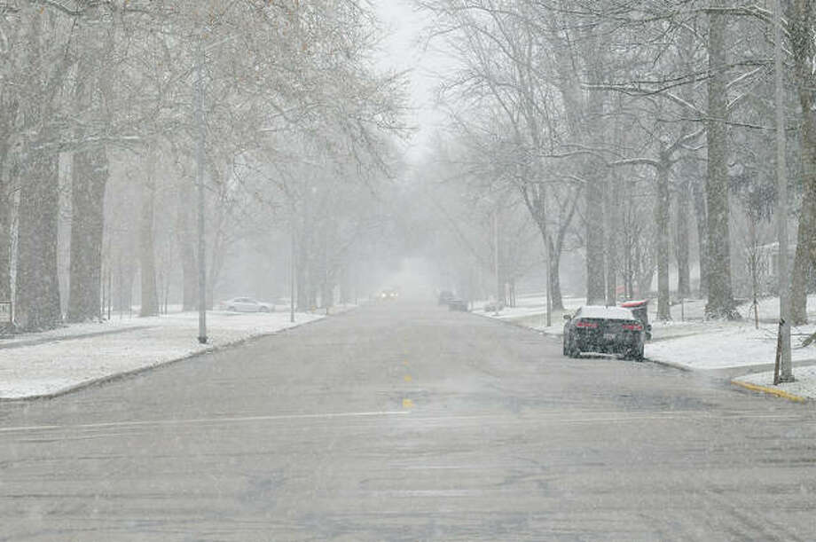 Snow falling Wednesday starts turning State Street white and cutting visibility for drivers. A winter storm system that moved across the region was expected to leave from 2 to 4 inches of snow by this morning and usher in bitter cold temperatures this evening.