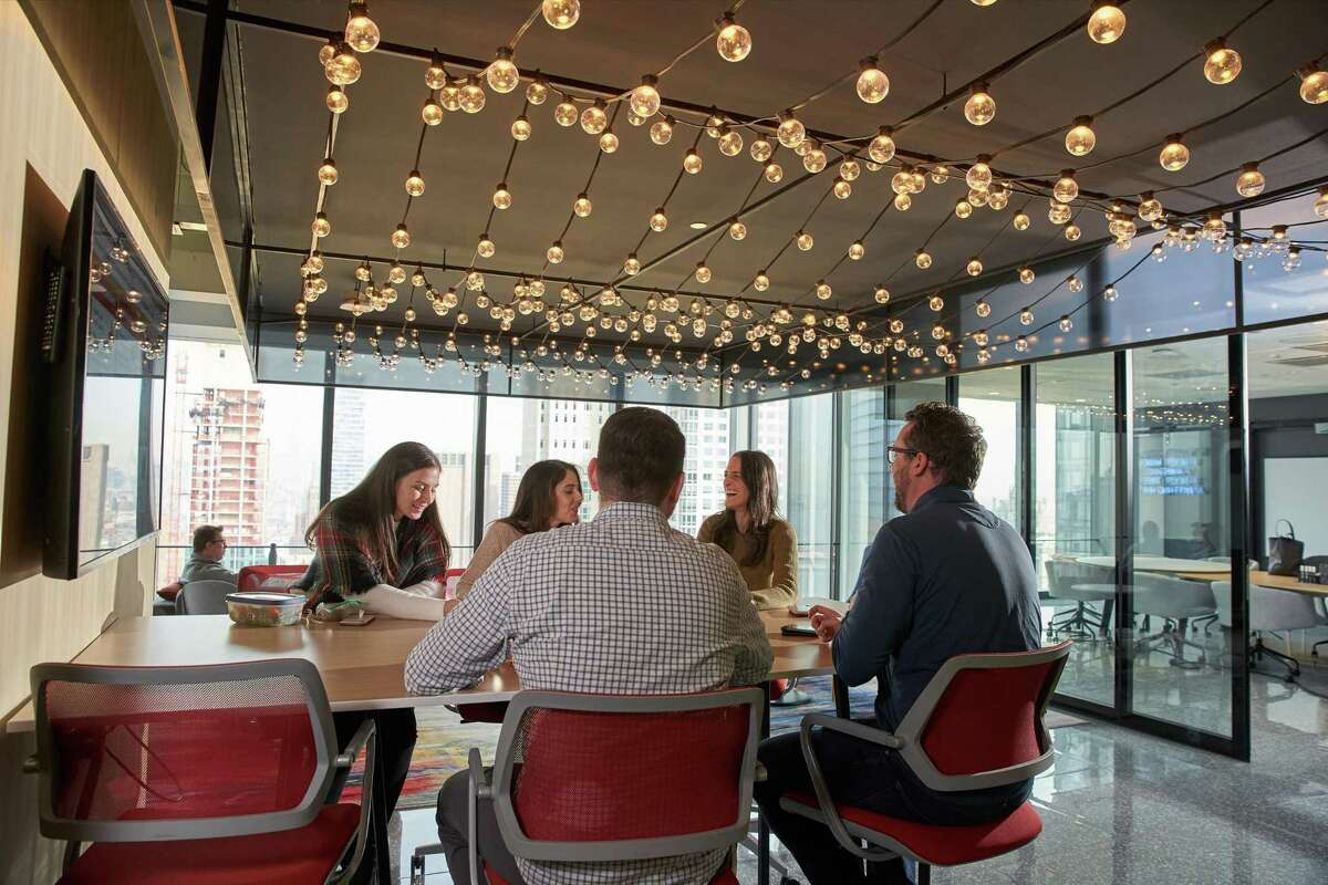 A Diageo corporate photo of employees at the company's new headquarters office at 3 World Trade Center in New York City. (Photo via PRNewswire)
