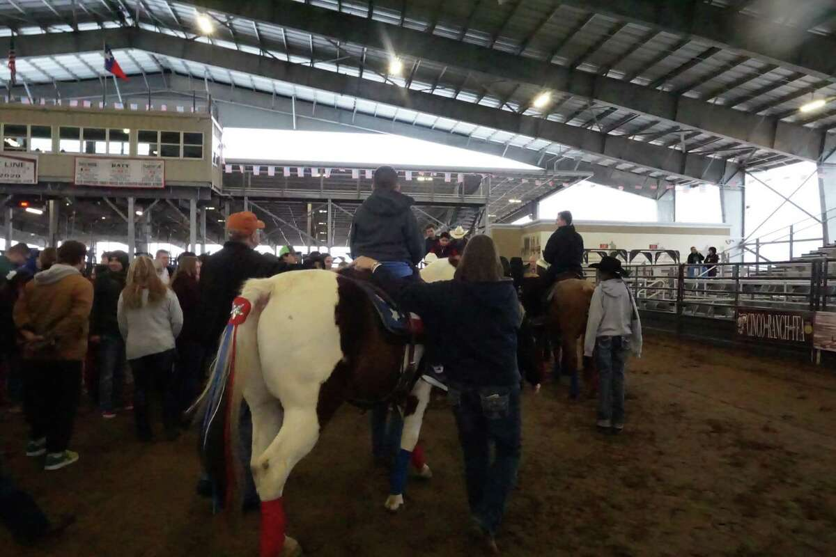 A special needs student is guided on a horse at the Katy Independent School District Special Rodeo on Wednesday, Feb. 12, at the Gerald D. Young Agricultural Sciences Center.