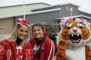 Katy High School cheerleaders Lexi Skillern and Brooke Matus and the Katy the Tiger pose as they wait to greet students at the Katy Independent School District Special Rodeo on Wednesday, Feb. 12, at the Gerald D. Young Agricultural Sciences Center.