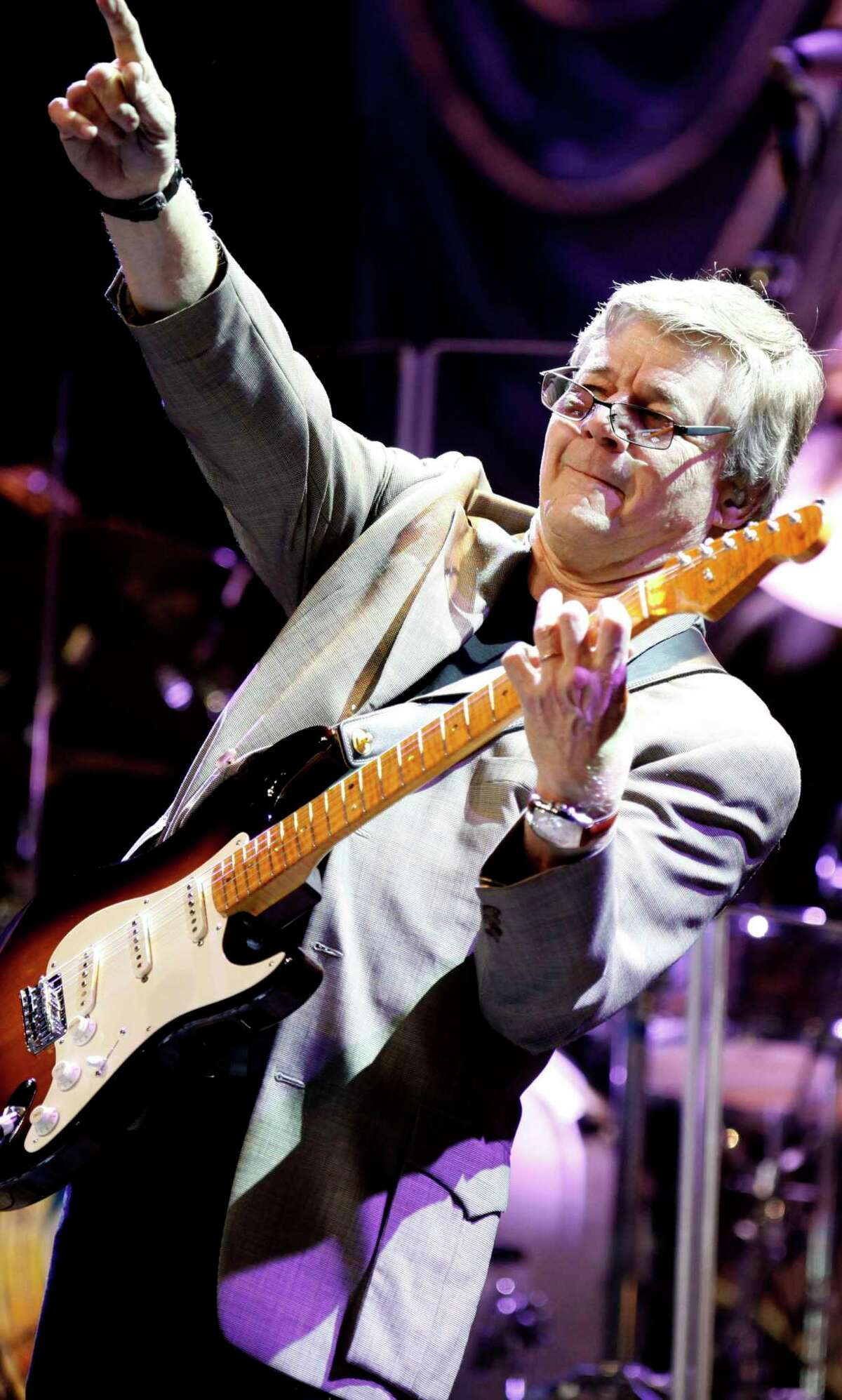 Steve Miller from the Steve Miller Band points to the heavens honoring his friend the late Bay Area harmonic legend Norton during a tribute concert for buffalo that fetured Bonnie Raitt and the Doobie Bros along with a dozen gust appearance at the Fox Theater in downtown Oakland Saturday night Jan 23, 2010. By Lance Iversen/The Chronicle